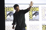 Tom Cruise waves to the audience after presenting a clip from