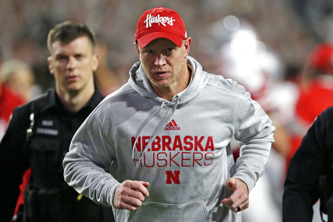 Nebraska head coach Scott Frost runs off the field following an NCAA college football game against Ohio State in Lincoln, Neb., Saturday, Sept. 28, 2019. Ohio State won 48-7. (AP Photo/Nati Harnik)
