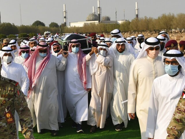 In this photo released by Diwan Al Amiri, the body of the late Emir of Kuwait Sheikh Sabah Al Ahmad Al Sabah is carried during his funeral ceremony in Kuwait, Wednesday, Sept. 30, 2020. The late Emir drew on his decades as the oil-rich nation's top diplomat to push for closer ties to Iraq after the 1990 Gulf War and solutions to other regional crises, died Tuesday, Sept. 29, 2020. He was 91. (Diwan Al Amiri via AP)