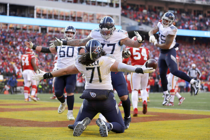 Tennessee Titans' Dennis Kelly (71) celebrates after catching a touchdown pass during the first half of the NFL AFC Championship football game against the Kansas City Chiefs Sunday, Jan. 19, 2020, in Kansas City, MO. (AP Photo/Jeff Roberson)