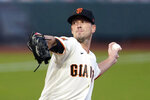 San Francisco Giants' Drew Smyly throws against the Seattle Mariners during a baseball game in San Francisco, Wednesday, Sept. 16, 2020. Smyly became the first of the 181 free agents to switch teams when he agreed Monday, Nov. 16, 2020, to an $11 million, one-year contract with the Atlanta Braves, who are looking to bolster a rotation that was depleted by injuries and disappointing performances. (AP Photo/Jeff Chiu)