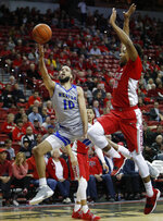 Nevada's Caleb Martin (10) shoots next to UNLV's Nick Blair (20) during the second half of an NCAA college basketball game Tuesday, Jan. 29, 2019, in Las Vegas. Nevada won 87-70. (AP Photo/John Locher)