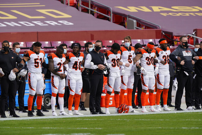 Members of the Cincinnati Bengals link arms before the start of the first half of an NFL football game against the Washington Football Team, Sunday, Nov. 22, 2020, in Landover. (AP Photo/Susan Walsh)