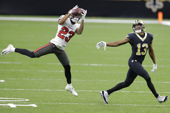 Tampa Bay Buccaneers cornerback Sean Murphy-Bunting (23) intercepts a pass intended for New Orleans Saints wide receiver Michael Thomas (13) during the first half of an NFL divisional round playoff football game, Sunday, Jan. 17, 2021, in New Orleans. (AP Photo/Brett Duke)