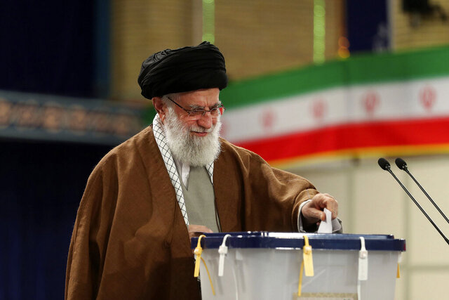 In this photo released by the official website of the office of the Iranian supreme leader, Supreme Leader Ayatollah Ali Khamenei casts his ballot in the parliamentary elections, in Tehran, Iran, Friday, Feb. 21, 2020. Iranians began voting for a new parliament Friday, with turnout seen as a key measure of support for Iran's leadership as sanctions weigh on the economy and isolate the country diplomatically. (Office of the Iranian Supreme Leader via AP)