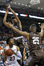 Auburn forward Isaac Okoro (23) looks to score past Lehigh guard Evan Taylor (5) and forward Ed Porter (25) during the second half of an NCAA college basketball game Saturday, Dec. 21, 2019, in Auburn, Ala. (AP Photo/Julie Bennett)