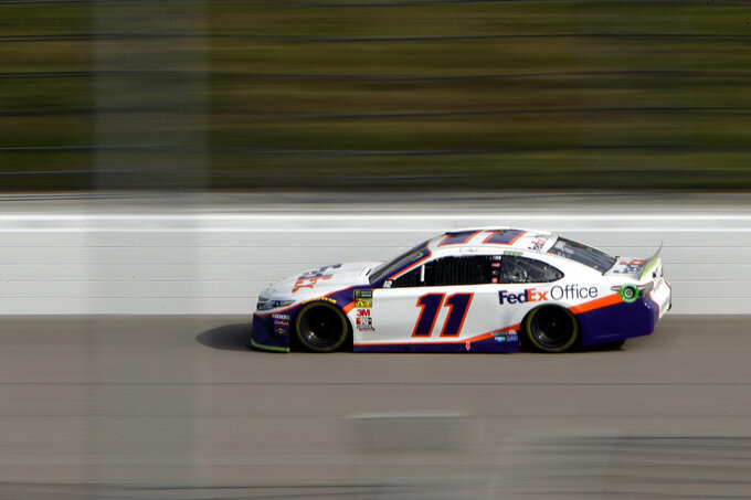 Denny Hamlin drives during a NASCAR Cup Series auto race at Kansas Speedway in Kansas City, Kan. Sunday, Oct. 20, 2019. Hamlin won the race. (AP Photo/Charlie Riedel)