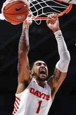 FILE - In this Feb. 22, 2020, file photo, Dayton's Obi Toppin (1) reacts as he dunks the ball in the second half of an NCAA college basketball game against Duquesne in Dayton, Ohio. Toppin was selected to The Associated Press All-America first team, Friday, March 20, 2020. (AP Photo/Aaron Doster, File)