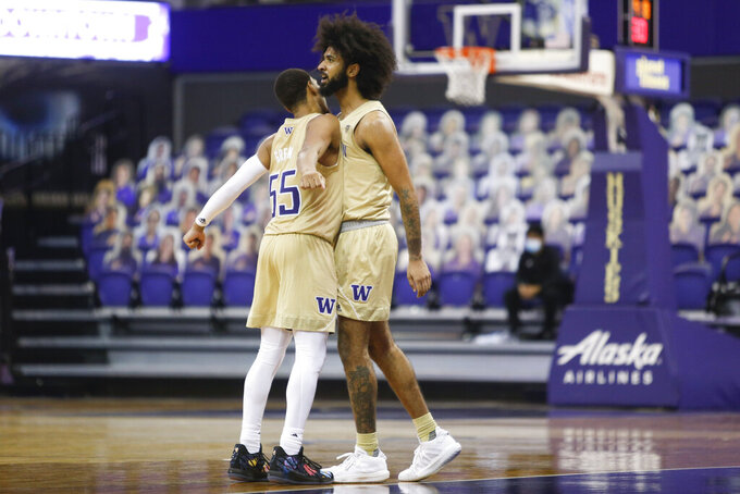Washington's Marcus Tsohonis, right, celebrates with Quade Green after making a 3-pointer against Colorado during the second half of an NCAA college basketball game Wednesday, Jan. 20, 2021, in Seattle. (AP Photo/Joe Nicholson)