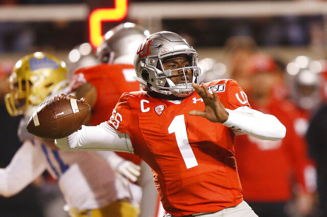 Utah quarterback Tyler Huntley (1) passes the ball against UCLA in the first half during an NCAA college football game Saturday, Nov. 16, 2019, in Salt Lake City. (AP Photo/Rick Bowmer)