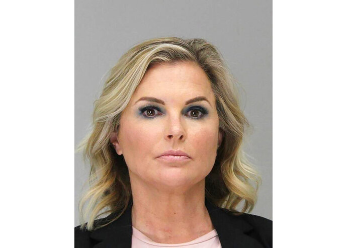 This Tuesday, May 5, 2020 booking photo provided by the Dallas County Sheriff's Office shows Shelly Luther. Luther was ordered to spend a week in jail after she continued to operate her business despite being issued a citation last month for keeping open her Dallas salon due to restrictions put in place because of the coronavirus pandemic. Luther's hearing occurred as Texas Gov. Greg Abbott relaxed more restrictions statewide, allowing barbershops and hair salons to reopen Friday. (Dallas County Sheriff's Office via AP)
