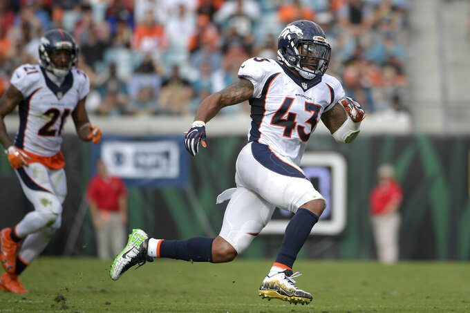 "FILE - In this  Sunday, Dec. 4, 2016 file photo, Denver Broncos strong safety T.J. Ward (43) follows a play during the first half of an NFL football game against the Jacksonville Jaguars in Jacksonville, Fla. T.J. Ward, one of the members of the Denver Broncos' famed ""No Fly Zone"" secondary, announced his retirement from the NFL on Wednesday, April 21, 2021. Ward helped the Broncos win Super Bowl 50. Ward played eight seasons in the NFL with Cleveland, Denver and Tampa Bay. He last played in 2017 for the Buccaneers.(AP Photo/Phelan M. Ebenhack, File)"
