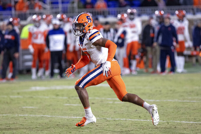 FILE - In this Nov. 16, 2019, file photo, Syracuse's Andre Cisco (7) defends on a play during an NCAA college football game against Duke in Durham, N.C. Cisco was selected to The Associated Press preseason All-America first-team, Tuesday, Aug. 25, 2020.  (AP Photo/Ben McKeown, FIle)