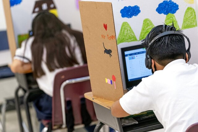 In this Friday, Sept. 18, 2020, photo students work in class at Meridien Public Charter School, in Washington. Several DC charter schools have been doing in-person teaching for small groups of students. (AP Photo/Andrew Harnik)