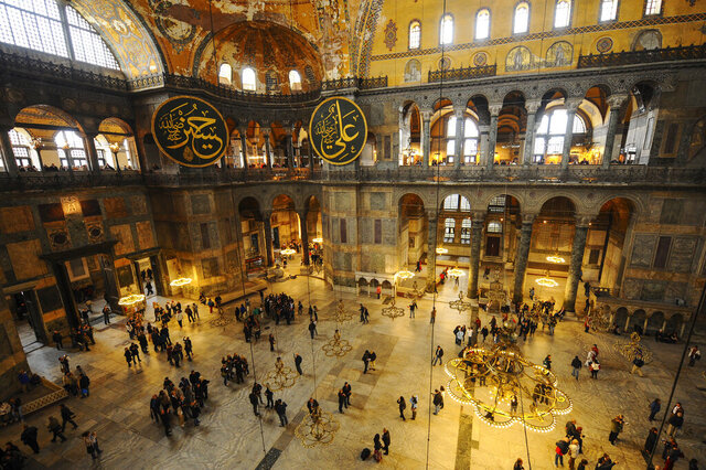 Visitors walk inside the Byzantine-era Hagia Sophia, in the historic Sultanahmet district of Istanbul, Friday, Oct. 15, 2010. Turkish President Recep Tayyip Erdogan is scheduled to join hundreds of worshipers Friday, July 24, 2020, for the first Muslim prayers at the Hagia Sophia in 86 years, weeks after a controversial high court ruling paved the way for the landmark monument to be turned back into a mosque. (AP Photo/Emrah Gurel)