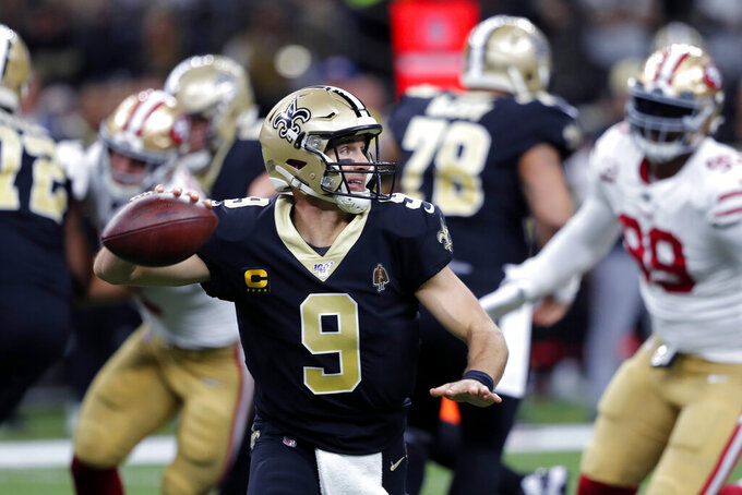 New Orleans Saints quarterback Drew Brees (9) scrambles as he throws a touchdown pass in the first half an NFL football game against the San Francisco 49ers in New Orleans, Sunday, Dec. 8, 2019. (AP Photo/Gerald Herbert)