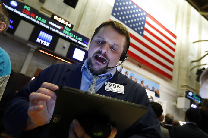FILE - In this Jan. 9, 2020, file photo trader Michael Milano works on the floor of the New York Stock Exchange. The U.S. stock market opens at 9:30 a.m. EST on Friday, Jan. 31. (AP Photo/Richard Drew, File)
