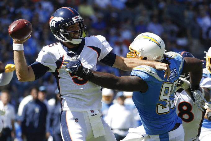 Denver Broncos quarterback Joe Flacco passes under pressure from Los Angeles Chargers defensive tackle Justin Jones during the first half of an NFL football game Sunday, Oct. 6, 2019, in Carson, Calif. (AP Photo/Alex Gallardo)