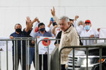 Mexican President Andres Manuel Lopez Obrador waves to supporters in Lazaro Cardenas, Quintana Roo state, Mexico, Monday, June 1, 2020. Amid a pandemic and the remnants of a tropical storm, President Lopez Obrador kicked off Mexico's return to a