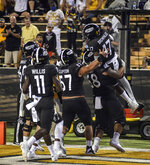 Southern Mississippi celebrates after wide receiver Jason Brownlee caught a touchdown pass during an NCAA college football game against Louisiana Tech in Hattiesburg, Miss., Saturday, Sept. 19, 2020. (Cam Bonelli/Hattiesburg American via AP)