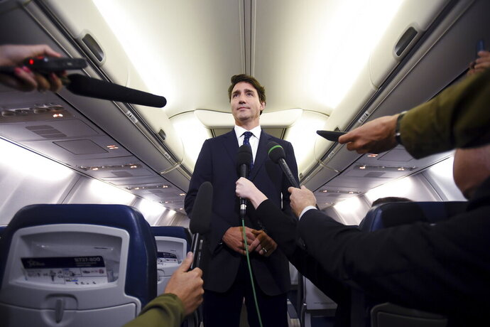 Canadian Prime Minister and Liberal Party leader Justin Trudeau makes a statement in regards to a photo coming to light of himself from 2001, wearing