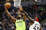 Minnesota Timberwolves forward Andrew Wiggins (22) shoots against Toronto Raptors forward Pascal Siakam (43) in the second quarter of an NBA basketball game Saturday, Jan. 18, 2020, in Minneapolis. (AP Photo/Andy Clayton-King)