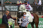 Tiz the Law (8), with jockey Manny Franco up, poses for a photo with assistant trainer Robin Smullen after winning the 152nd running of the Belmont Stakes horse race, Saturday, June 20, 2020, in Elmont, N.Y. (AP Photo/Seth Wenig)