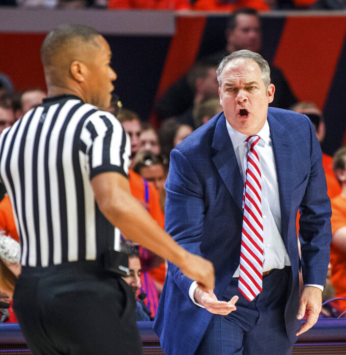Rutgers head coach Steve Pikiell, right, works the referee during of an NCAA college basketball game against Illinois in Champaign, Ill., Saturday, Feb. 9, 2019. (AP Photo/Robin Scholz)