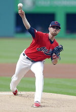 Cleveland Indians starting pitcher Shane Bieber delivers in the first inning of a baseball game against the Atlanta Braves, Sunday, April 21, 2019, in Cleveland. (AP Photo/Tony Dejak)