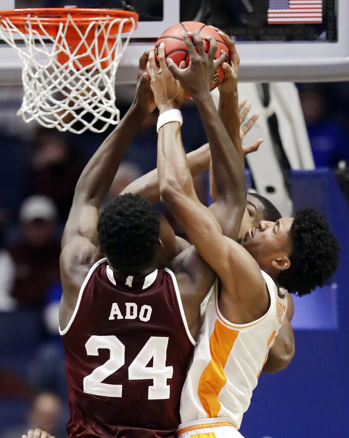 Tennessee forward Kyle Alexander, right, battles Mississippi State forward Abdul Ado (24) for the ball in the second half of an NCAA college basketball game at the Southeastern Conference tournament Friday, March 15, 2019, in Nashville, Tenn. Tennessee won 83-76. (AP Photo/Mark Humphrey)