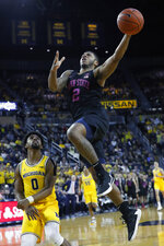Penn State guard Myles Dread (2) drives on Michigan guard David DeJulius (0) in the first half of an NCAA college basketball game in Ann Arbor, Mich., Wednesday, Jan. 22, 2020. (AP Photo/Paul Sancya)