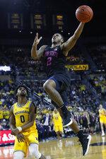 Penn State guard Myles Dread (2) drives on Michigan guard David DeJulius (0) in the first half of an NCAA college basketball game in Ann Arbor, Mich., Wednesday, Jan. 22, 2020. (AP Photo/Paul Sancya)