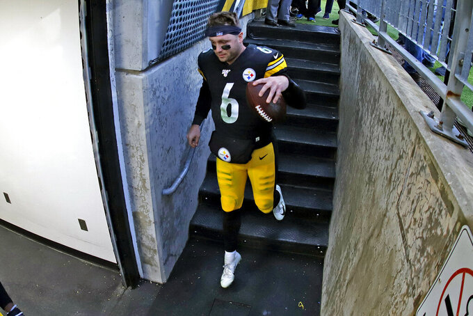 Pittsburgh Steelers quarterback Devlin Hodges heads to the locker room with a game ball following an NFL football game against the Cleveland Browns in Pittsburgh, Sunday, Dec. 1, 2019. (AP Photo/Gene J. Puskar)
