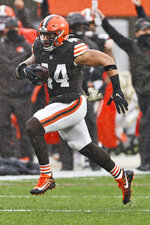 Cleveland Browns linebacker Sione Takitaki runs for a 50-yard interception return touchdown during the first half of an NFL football game against the Philadelphia Eagles, Sunday, Nov. 22, 2020, in Cleveland. (AP Photo/Ron Schwane)