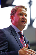Lane Kiffin speaks to Mississippi fans after being introduced as the new NCAA college football coach during a public introduction at The Pavilion, a multipurpose arena on the campus in Oxford, Miss., Monday, Dec. 9, 2019. Kiffin was previously, the football coach for three years at Florida Atlantic. (AP Photo/Rogelio V. Solis)