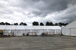 Quarantine tents set up for recruits arriving at the Marine Corps' Parris Island Recruit Depot, S.C., on May 27, 2020. The tents were used until earlier this week and now recruits go through quarantine at the Citadel, the Marine college in Charleston, S.C.  In ways big and small, the virus is impacting training at the Marine Corps' Parris Island Recruit Depot and across the military. (AP Photo/Lolita Baldor)
