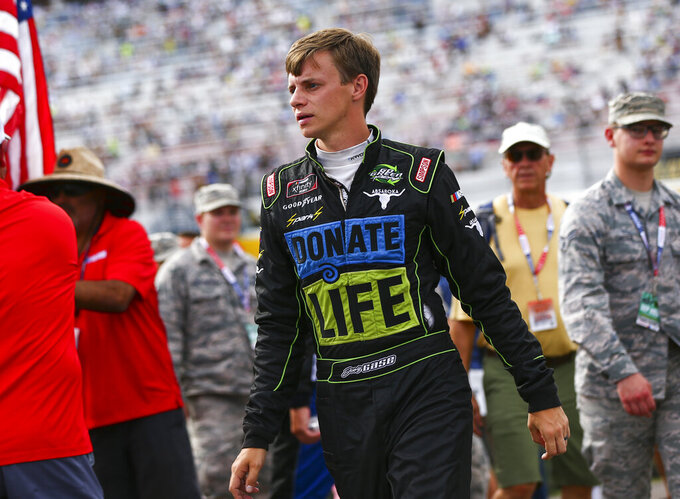 Joey Gase walks to his car before a NASCAR Cup Series auto race at the Las Vegas Motor Speedway on Sunday, Sept. 15, 2019. (AP Photo/Chase Stevens)