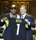 Michigan linebacker Devin Bush poses with NFL Commissioner Roger Goodell after the Pittsburgh Steelers selected Bush in the first round at the NFL football draft, Thursday, April 25, 2019, in Nashville, Tenn. (AP Photo/Steve Helber)