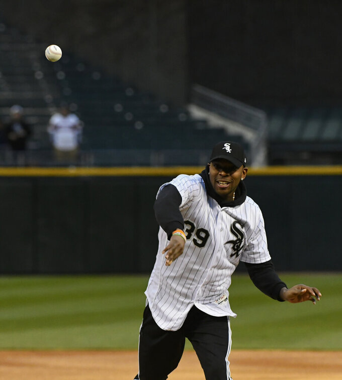 Chicago Bears player Eddie Jackson throws out a ceremonial first pitch before a baseball game between the Chicago White Sox and the Kansas City Royals, Monday, April 15, 2019, in Chicago. (AP Photo/Matt Marton)