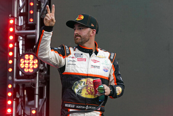 Austin Dillon waves to fans during driver introductions before the NASCAR Cup Series auto race at Daytona International Speedway, Saturday, Aug. 28, 2021, in Daytona Beach, Fla. (AP Photo/John Raoux)