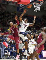 Temple's Nate Pierre-Louis (15) and Connecticut's Tarin Smith (2) collide under the basket during the first half of an NCAA college basketball game, Thursday, March 7, 2019, in Storrs, Conn. (AP Photo/Stephen Dunn)