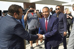 James Craig, a former Detroit Police Chief, shakes hands with supporters after announcing he is a Republican candidate for governor of Michigan in Detroit, Tuesday, Sept. 14, 2021. (AP Photo/Paul Sancya)