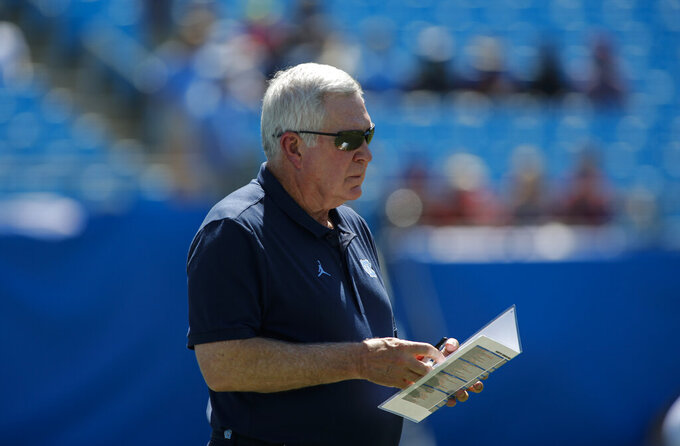 North Carolina head coach Mack Brown watches his team warm up prior to an NCAA college football game against South Carolina in Charlotte, N.C., Saturday, Aug. 31, 2019. (AP Photo/Nell Redmond)