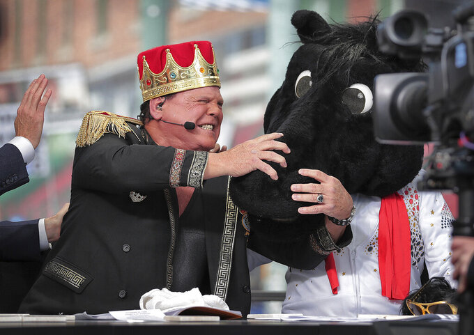 """Memphis wrestler Jerry Lawler reacts as ESPN's """"College GameDay"""" host Lee Corso dons the mascot head of SMU, picking the Mustangs over the Tigers for Saturday night's matchup between the two nationally ranked AAC teams, during the ESPN's """"College GameDay,"""" Saturday, Nov. 2, 2019, on Beale Street in Memphis, Tenn. (Jim Weber/Daily Memphian via AP)"""