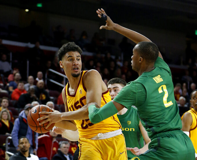 FILE - In this Feb. 21, 2019, file photo, Southern California's Bennie Boatwright (25) looks to pass the ball against Oregon's Louis King (2) during the second half of an NCAA college basketball game in Los Angeles. USC has an explosive offensive player in Boatwright, who has made 19 3-pointers in his last three games. He made 10, tying a Pac-12 record, in a win at California on Feb. 16. (AP Photo/Ringo H.W. Chiu, File)