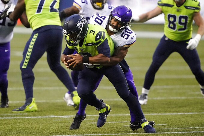 Minnesota Vikings outside linebacker Eric Wilson (50) sacks Seattle Seahawks quarterback Russell Wilson during the first half of an NFL football game, Sunday, Oct. 11, 2020, in Seattle. (AP Photo/Ted S. Warren)