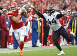 Kansas City Chiefs tight end Travis Kelce (87) makes a catch against Jacksonville Jaguars linebacker Myles Jack (44) during the second half of an NFL football game in Kansas City, Mo., Sunday, Oct. 7, 2018. (AP Photo/Ed Zurga)