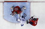 Washington Capitals goaltender Braden Holtby (70) blocks a shot by Tampa Bay Lightning center Tyler Johnson (9) with Capitals defenseman Michal Kempny (6), from the Czech Republic, nearby during the first period of Game 3 of the NHL Eastern Conference finals hockey playoff series Tuesday, May 15, 2018, in Washington. (AP Photo/Alex Brandon)