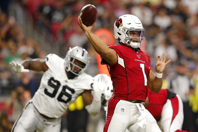 Arizona Cardinals quarterback Kyler Murray (1) throws as Oakland Raiders defensive end Clelin Ferrell (96) pursues during the first half of an an NFL football game, Thursday, Aug. 15, 2019, in Glendale, Ariz. (AP Photo/Ralph Freso)