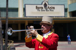 In this Friday, May 22, 2020 photo, bugler Jay Cohen blows
